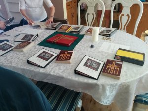 The small congregation sits around a dining room table.